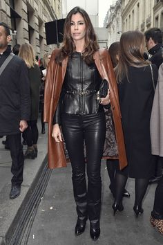 Christina Pitanguy attends the Elie Saab Haute Couture Spring Summer 2017 show black leather top and pants with brown leather coat