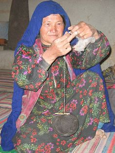 A Hazara woman spinning yarn (Afghanistan). Note no spindle is used.