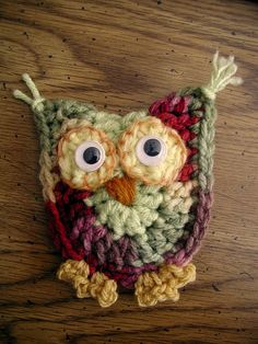 Ravelry: buckster's Whoo - Whoo. Looks like this was worked in dbl crochet in oval shape, folded over and crocheted together using dbl crotchets at the horns.  Very cute!