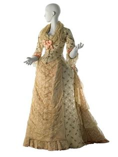 House of Worth Afternoon Dress, 1876. This afternoon dress exemplifies the atelier's proclivity for 18th-century inspired design in its lighthearted combination of pink and white rose sprig meanders, ecru bobbin lace tablier, and lace engageantes.