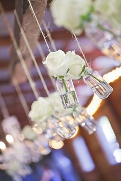 White roses in hanging mason jars - North Georgia Wedding at Vinewood Plantation from Alucinarte Films