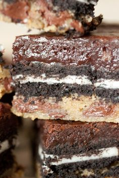 """Slutty brownies- layers of choc chip cookie dough, oreos & brownies, whoa! <-- I need to make these if only because they are called """"slutty brownies"""" Köstliche Desserts, Delicious Desserts, Dessert Recipes, Yummy Food, Cheesecake Desserts, Raspberry Cheesecake, Plated Desserts, Brownie Recipes, Desert Recipes"""