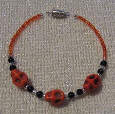 Orange Skull Bracelet by SummerCAmber on Etsy, $11.50