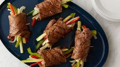 Tender steak rolls filled with zesty vegetables drizzled with a glaze
