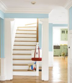 These foyer columns are a nod to classic Greek pillars.