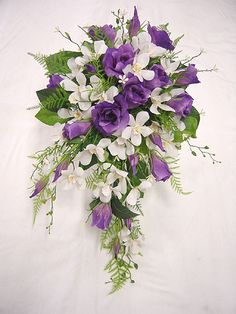 Teardrop Bouquet with white dendrobim orchids and purple lysianthus