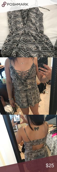 Flower lace up romper Super cute and flowy flower lace up romper from American Eagle. Size Small. It's perfect for spring and summer! Has some beading in the middle chest area where the laces are. Barely worn! American Eagle Outfitters Pants Jumpsuits & Rompers