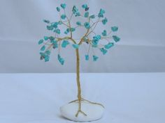 Check out this item in my Etsy shop https://www.etsy.com/listing/245025599/turqoise-gemstone-wire-tree