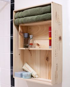 DIY shelving from wine crates. I would paint this, probably white on the outside with bright colors on the inside! Great bathroom storage on the cheap.