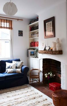 fireplace, mantel, books, pillows, pendant...pretty little details.
