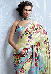 Envelope yourself in classic look with this charming saree. This cream and shaded blue brasso faux georgette saree is nicely designed with floral, geometric print, lace and patch work. Saree gives you a singular and dissimilar look. Matching blue blouse is available. Slight color variations are possible due to differing screen and photograph resolution.