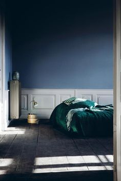 Blue & green bed on floor
