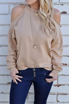 A cold shoulder sweatshirt featuring distressing and a cut out open back.  100% Cotton Hand wash Model is wearing size Small Size info: Runs true to size with a loose, relaxed fit.  Shop The Look: Easton Skinny Jeans