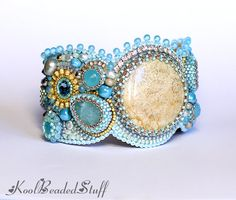 Bead embroidered bracelet with a fossil coral por koolbeadedstuff