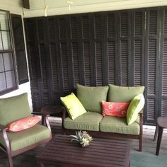 Dark grey outdoor shutters - provide complete privacy when closed.  Paint all timber panels to match