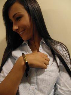 """Bombshell For All"" Bracelet: Handmade black cord & recycled bomb shell bracelet made by a blind female artisan in Cambodia. Read more about the artisan & her journey: http://shopanthropic.com/bombshell-for-all-bracelet-12090"