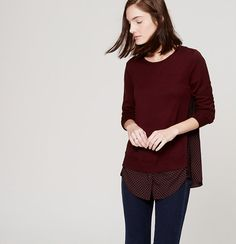 A clever approach to a cool layered look, we love the sweater-meets-blouse effect of this alluring style. Round neck. Long sleeves. Knit front and sleeves. Woven front hem and back. Box pleat beneath back yoke.