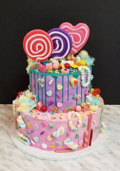 A fun, whimisical design that covers your favourite cake flavour in bright, colourful candy, cotton candy, and sprinkles.  Available in all sizes and flavours.  Single, or multi-tier. Colorful Candy, Candy Colors, Cake Flavors, Drip Cakes, Candyland, Baby Shower Cakes, Cotton Candy, Sprinkles, Birthday Cake