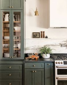 Yay or Nay: Moody Green Interiors – Green cabinets and brass hardware with soapstone counters. – - Yay or Nay: Moody Green Interiors - Green cabinets and brass hardware with soap. Updated Kitchen, New Kitchen, Kitchen Dining, Eclectic Kitchen, Kitchen Ideas, Kitchen Trends, Kitchen Layout, Open Shelf Kitchen, Tudor Kitchen