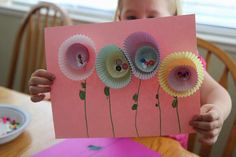 Decorative Cupcake Liner Flowers On A Chart paper