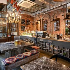 Aside from all the pipework, machinery and general gubbins, which itself is an attractive feature, the interior, designed by founder Jennifer Liu, benefits from some lovely Victorian-looking false-arched brickwork...