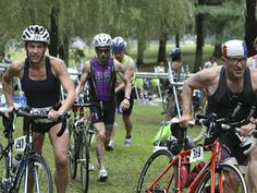 Determined athletes transitioning in the Luray Triathlon in #Luray, Virginia - www.luraytriathlon.com.  #luraytriathlon