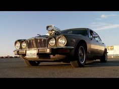 Speaking of Jag's. Great stuff with the conversion.  On this episode of Roadkill, Freiburger and Finnegan do unspeakable things to a '74 Jaguar XJ12, one of about 4,700 made. Namely, they cut a giant hole in the hood and install a Weiand 6-71 supercharger and twin Holley carburetors on the 350ci Chevy V8 that was already installed in the car when it was purchased for $1,000. But things can never b...