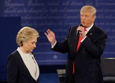 <p>Democratic presidential nominee Hillary Clinton walks past Republican presidential nominee Donald Trump during the second presidential debate at Washington University in St. Louis, Sunday, Oct. 9, 2016. (Photo: Patrick Semansky/AP)</p>