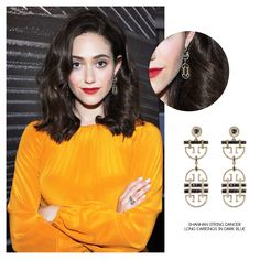 Hollywood actress and singer-songwriter, Emmy Rossum strikes a pose while attending the launch of Burt's Bees Beauty's I Am Not Synthetic Campaign held at the Eventi Hotel in New York City, wearing the Shanhan String Dancer Long Earrings in Dark Blue.
