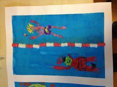 Zwemmer met wasco getekend, ecoline erover en een drijflijn van playmais