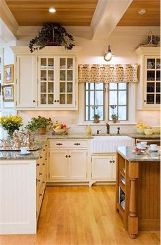 different wooden floors but the layout of this kitchen is perfect