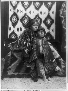 Brother & sister, Portrait of two Navajo children seated, ca1915