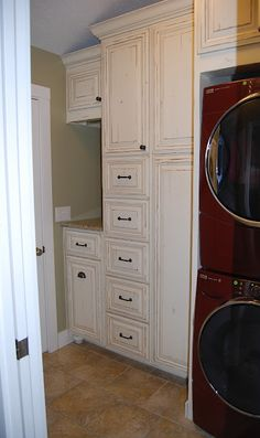 Small Laundry room with stacked washer and dryer.