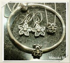 PANDORA Matching Hawthorn Earrings, Necklace and Bangle.
