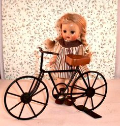 Miniature Bicycle . Old Fashioned Style. Doll . Toy. Home Decor . Wrought Iron    This is a miniature doll sized bycicle. Measures 5 x 8. Bycicle has a