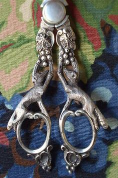 Very old antique silver grape shears with fox design