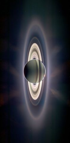 This is a real image of Saturn, taken by the robotic spacecraft Cassini, eclipsing the Sun (scheduled via http://www.tailwindapp.com?ref=scheduled_pin&post=179925)