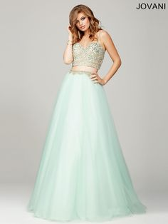 Two-piece long dress with a spaghetti strap sweetheart neckline top with beaded embellishments features a tulle ballgown skirt