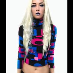 Vintage Retro 70s Style Psychedelic Crop Top Super rad 70's style turtleneck. True vintage, made in the 80s-90s. Turtleneck. Long sleeve. Sheer retro magenta, pink, and blue toned print layered over matte black material. Stretchy. 100% cotton. No size tag but I'm a S. I'm pretty sure it can fit a XS and smaller M size due to the stretch. Super rare/HTF. In great vintage condition (no rips or tears). Like Unif. • Retro • 70s Style • Psychedelic • Funky • Rad • Vintage • 90s • Disco bby…