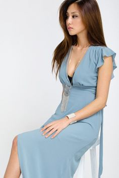 'Italian Villa' Dress - Enjoy the summer months in your 'italian villa' wearing this beautiful sundress and drink in the wine and the countryside! This midi length woven dress features beautiful flutter cap sleeves and a hi-lo hemline. The sky blue wrap style dress has an empire waistline with a plunging v-neckline. This flowy, lightweight dress is fully lined and very feminine so 'salute' to a good wine and a great dress! Available in Sky Blue. 100% Polyester.