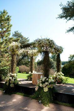 A Botanical Chuppah | 23 Wedding Chuppah Ideas We Love | https://www.theknot.com/content/creative-wedding-chuppah-ideas