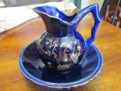 Vintage Asian Japanese Miniature Pitcher and Bowl Cobalt Blue Gold Trim Peafowl Pair and Beautiful Multicolored Flowers. Nice pitcher and handle design. No marks on bottom. Vase is 3 Bowl is 5 wide tall. Porcelain Ceramics, China Porcelain, Peafowl, Selling On Ebay, Colorful Flowers, Cobalt Blue, Dinnerware, Vintage Items, Miniature