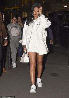 Rihanna commands attention in white minidress in Paris Casually-cool: The songstress opted for comfort on her feet with white trainers and accessorised her chic white ensemble with a crocodile print handbag and silver hoop earrings Rihanna Outfits, Rihanna Casual, Rihanna Dress, Rihanna Street Style, Celebrity Outfits, Celebrity Style, Rihanna Fashion, Rihanna Sneakers, Paris Fashion