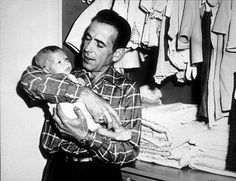 Humphrey Bogart and his son, Stephen, at home, 1949.