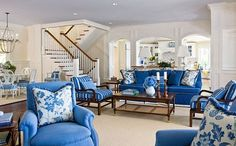 Interior designer Kelley Proxmire selected indoor/outdoor fabrics for the living room, then created interest by using florals, stripes, and contrasting piping and trim to twist the tried-and-true color scheme.