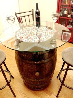 Table made from a wine barrel. I think I would like wine corks instead of the beer caps though!