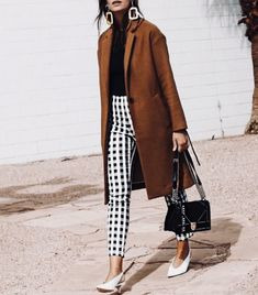 This is a very stylish outfit, black and whites in all styles and covered with a trendy tan coat | Top fashion trends and outfits for women who love fashion.