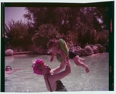 Lucille Ball and Desi Arnaz at home with their daughter, Lucie, in their swimming pool