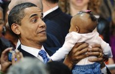 US Democratic presidential candidate Senator Barack Obama (D-IL) (C) reacts as he holds a baby at a rally in Columbia, South Carolina, January 20, 2008. REUTERS/Jonathan Ernst (UNITED STATES)  US PRESIDENTIAL ELECTION CAMPAIGN 2008 (USA) via @AOL_Lifestyle Read more: http://www.aol.com/article/news/2016/11/20/reporter-to-obama-are-you-worried-about-being-the-last-democrat/21610501/?a_dgi=aolshare_pinterest#fullscreen