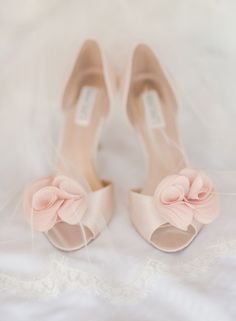 Pink rosette bridal #shoes | Photography: Rebecca Yale Portraits - www.rebeccayaleportraits.com/ Read More: http://www.stylemepretty.com/2014/07/31/springtime-wedding-in-brooklyn/